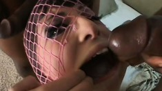 Kinky brunette in pink fishnet stockings gets fucked by two black guys