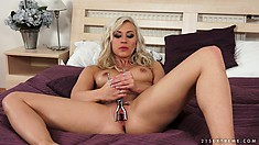 She has a big dildo drilling her twat deep and a sex toy spreading her pussy lips