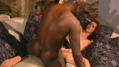 Redhead goes interracial with a black rod and nibbles before fucking