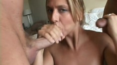 Tanned blonde with a superb ass has two horny guys sharing her holes