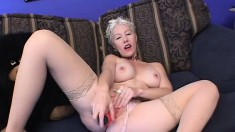Horny mature lady with short blonde hair and big boobs has fun with two black studs