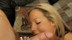 She rubs her clit while sucking his cock and swallows it all