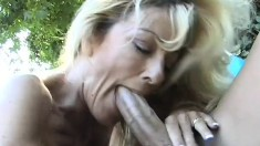 Hot mommy with pierced clit enjoying a hard meaty cock alfresco