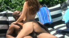 Little redhead is outside with the sun and a black cock getting hammered