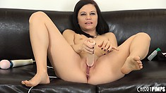 Brandi Belle jams a massive flesh coloured dildo into her giant snatch