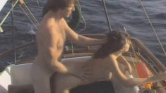 A horny couple go out to sea and have fun fucking on their boat