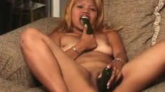 Candy likes veggies and uses a cucumber to fuck her slick slit