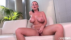 Big boobied brunette Sophie Dee titillates her twat with her favorite sex toy
