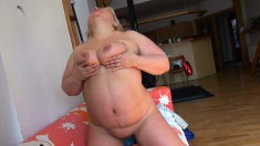 Fat, mature lady strips and touches herself spreading her pink lips