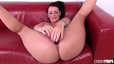 Sophie Dee having a good time with her toys and showing off her ass