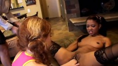 Interracial lesbian lovers using sex toys to make each other cum hard