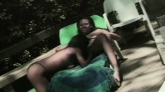 Ebony lesbians Jessica and Tiffany eat pussy outside on a lounge chair