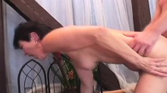Petite brunette mom screams with pleasure while bouncing on a big cock