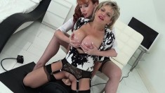 Two horny housewives with huge knockers go for a wild ride on the Sybian