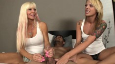 Two Ravishing Blondes Put Their Marvelous Hands To Work On A Fat Dick