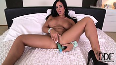she moans while her toy slides in and out of her till she cums