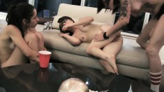 Three enticing babes explore their lesbian fantasy with a strap-on toy