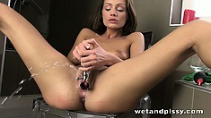The cute babe stretches her tight pink twat with her fingers and a sex toy