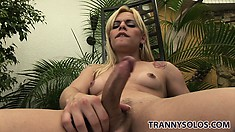 Thays sits on a chair in the backyard jerking on her hard boner