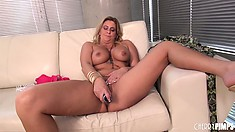 Busty blonde lady Phyllisha Anne lies on the couch and drives her cunt to pure pleasure