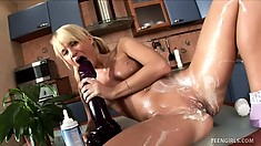 Michelle gets all creamed up to use her huge black dildo in her twat