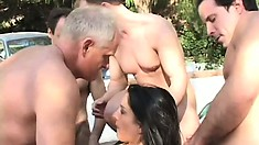 Lustful brunette with a sexy slim body Renee has fun with three horny dudes outside
