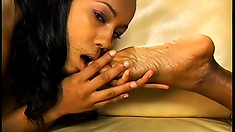 Black lesbians with a foot fetish lick stockinged feet and toy twat
