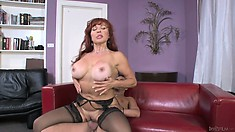 Busty mature redhead rides her new son in laws stiff boner on the couch
