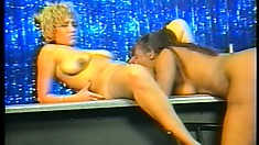 Horny lesbian bitches fuck each other at a strip club's stage