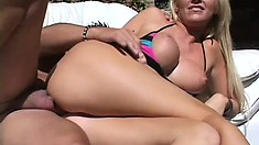 Blonde bombshell in a tight bikini gets tapped by her pool boy