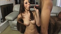 She uses her big tits to seduce this black guy and services him