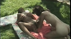 Two tight-bodied ebony lesbians enjoy playing with each other's clits