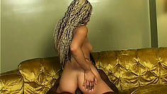 Caramel cutie slides a black dick in her ass and rides it with passion
