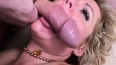 Blonde milf in stockings has the time of her life with two hung studs