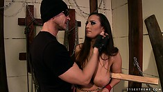 Busty brunette is his slave and is tied up and gets boobs whacked