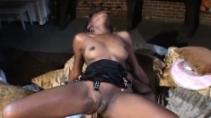 Ebony beauty jumps on top of the black stud and feeds her hungry holes his huge dick