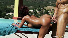 Leaning her luscious body over the massage table, she takes that big cock from behind