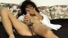 Naughty Oriental mom Song gives her hairy cunt the attention in needs
