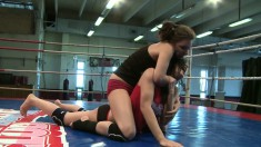 Sexy young babe Henessy wrestles naked with stunning Abbie Cat
