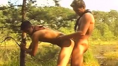Cute twinks exchange oral pleasures and enjoy anal sex in the bushes
