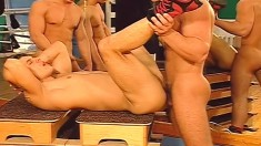 Athletic gay boys satisfying their needs in the ring and the showers