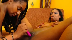 Hot ebony lesbians lick and finger pussy before fucking them with toys