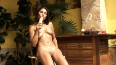 Bodacious brunette in high heels pounds her pussy with a big sex toy