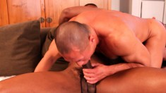 Interracial gay lovers kiss each other and engage in hardcore anal sex