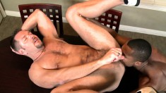 Interracial lovers on vacation take turns fucking each other's asses