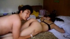 Asian Couple Are Making Love In A Hotel Room