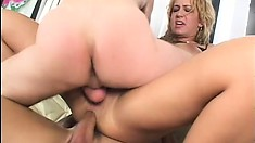 Babe with a pierced pussy takes on a pair of younger dudes at once