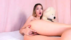 Sexy teen babe fingering her hot pussy in solo masturbation