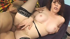 Redhead cougar in black stockings Mae Victoria takes a huge cock in her hairy cunt
