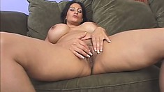 Naughty brunette milf with huge tits and a big booty feeds her hungry cunt a hard cock